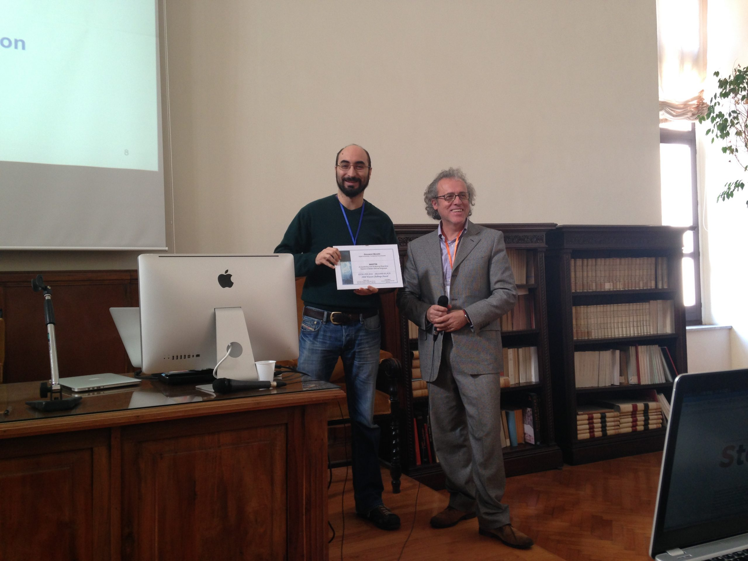 Giovanni receives the prizes from Piero Leo